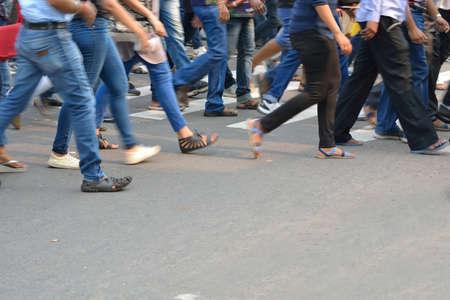 dont walk: Pedestrian are crossing in zebra crossing.
