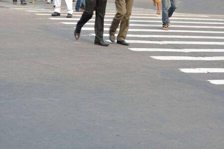 crossing: Pedestrian are crossing in zebra crossing.