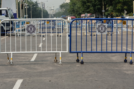 do not enter warning sign: Road is closed by barrier. Kolkata police closed the road for oath of CM West Bengal in Kolkata. Editorial