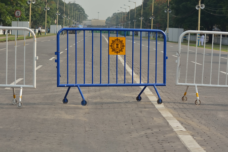 do not enter warning sign: Road is closed by fence. Kolkata police closed the road for oath of CM West Bengal in Kolkata.