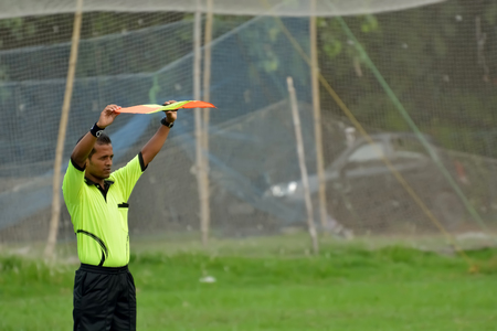 linesman: soccer linesman in a play. Editorial
