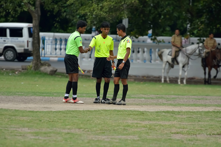 referees: Soccer referees are meeting together. Editorial