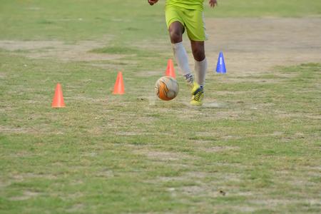 dribbling: Soccer players practicing dribbling. Editorial