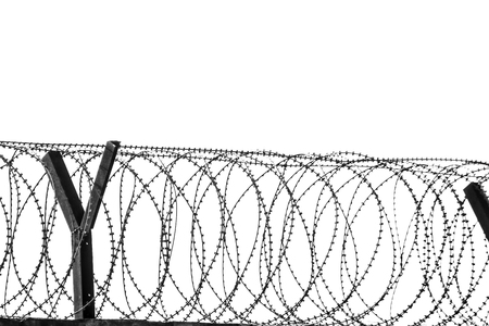 fencing wire: Barbed wire fencing around a prison.