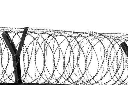 iron curtain: Barbed wire fencing around a prison.