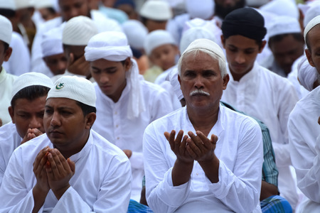 namaz: Indian Muslims are celebrating Eid in Calcutta. Their are praying to allah. Muslims on the road during the EID festival to  rad namaz in Calcutta, India. Editorial