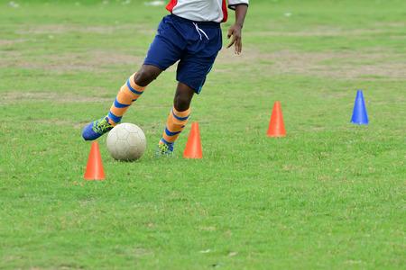 dribbling: Soccer players practicing dribbling. Stock Photo