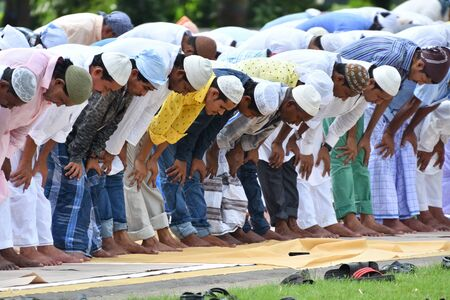 namaz: Indian Muslims are celebrating Eid in Calcutta. In Eid they are praying to Good on road in a Calcutta street dated 13.09.2016. In morning they are reading namaz. Editorial