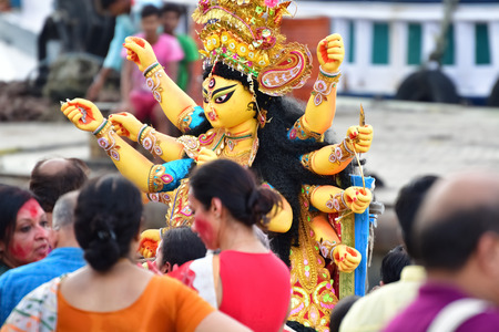 Immerse goddess Durga idol in ganges river during Durga Puja festival in Kolkata, India. Durga puja is the biggest festival in West Bengal.