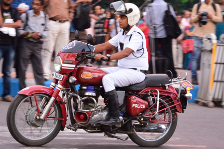 motorcycle officer: Calcutta, India - October 14, 2016: kolkata police traffic sergeant on Motorbike. During during Durga Puja festival they manage the idol Durga ceremony.