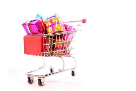 christmastime: Shopping Cart with Christmas or New Year gifts boxes on isolated white Stock Photo