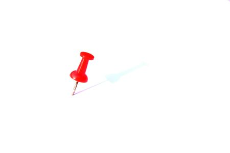 white pushpin: Red pushpin in isolated white background. Stock Photo