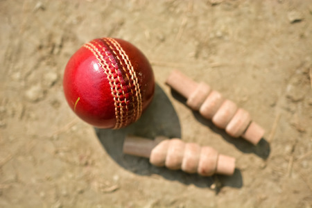 Cricket ball and bails on pitch