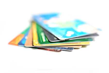 Set of credit cards on white background