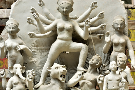 Goddess idols are being prepared with clay before festival. Idols being made for Durga Puja festival. Sculpture of goddess durga.