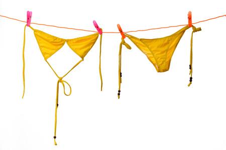 Bikini hanging on white background