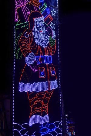 LED light Santa clause against black background.