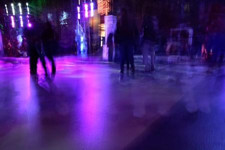Pedestrian is walking on city road in motion blur in a night