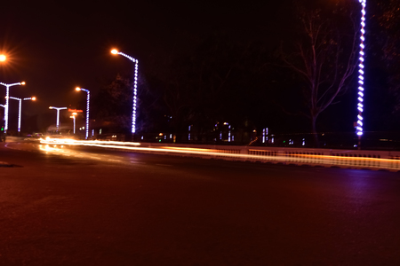 Car Light trails on a city street in a night