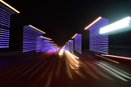 City road in radial blur in a dark night