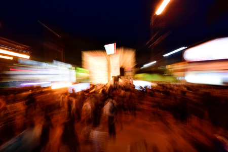 Night Crowds are in the downtown area. Zoom blur with long exposure in crowded area.