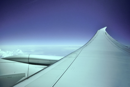 Airplane Engine & Wing in Mid-Air Stock Photo