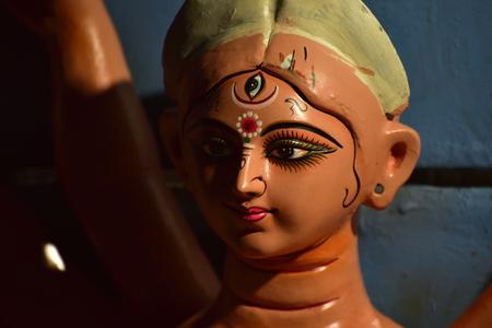 Close-up of Hindu idol goddess Durga ready to go puja mandap