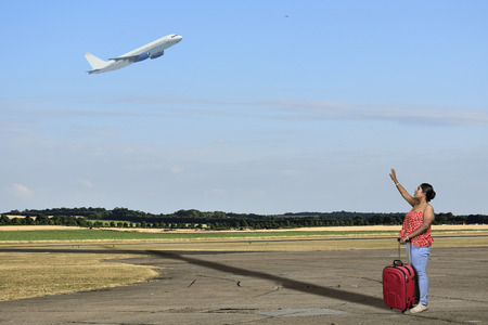 Woman lost airplane in airport runway to travel Reklamní fotografie