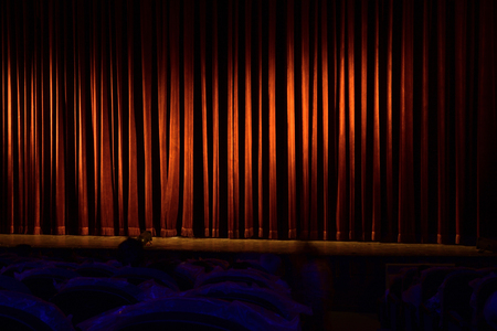 Red Curtain of theatrical stage as a background.