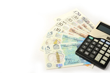 British Pound paper money and calculator isolated on white background