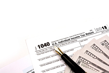 Calculating US tax with 1040 tax form on white background