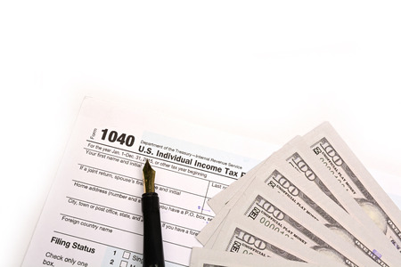 Completing US tax return form 1040 on white background.
