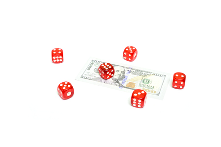 Dice and dollar bill isolated on white background