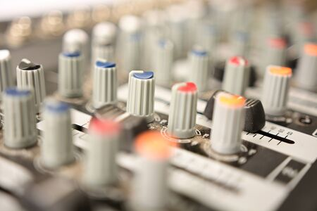 close-up of modern sound mixer in studio