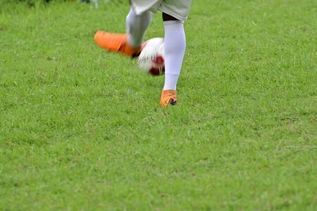 Soccer player is running to kick soccer ball