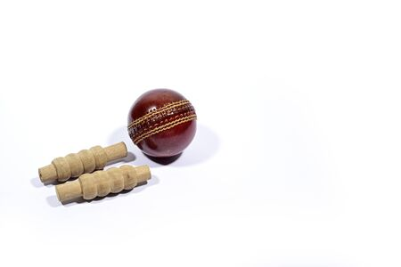 Cricket ball and bails are isolated on white background 写真素材