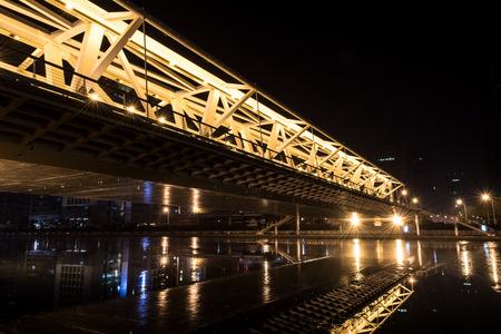 progressive: Progressive bridge at night Editorial