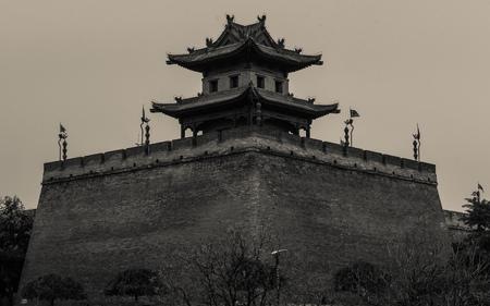 Xian ancient city wall corner building Editorial