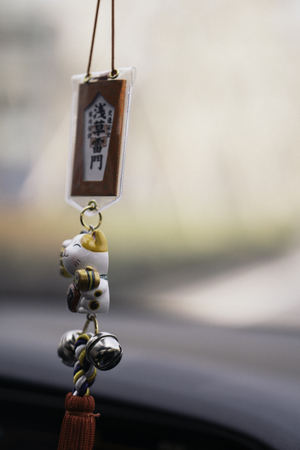 Lucky cat wind chime pendant Editorial