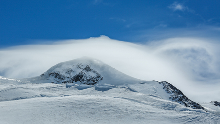 White winter mountains covered with snow in blue cloudy sky. Alps. Austria. Pitztaler Gletscher Stok Fotoğraf