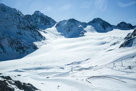 Winter landscape - Panorama of the ski resort with ski slopes. Alps. Austria. Pitztaler Gletscher. Wildspitzbahn