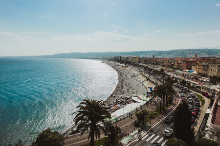 Panoramic view of Nice coastline and beach with blue sky, France. Summer