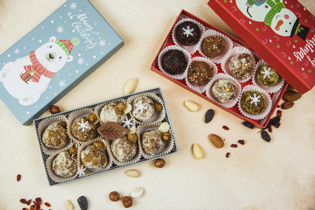Delicious organic homemade portioned raw candies stacked in gift Christmas boxes