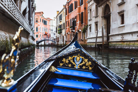 Traditional gondola on narrow canal in Venice, Italy 写真素材