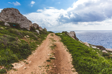Beautiful valley by the sea. Trail leading along the coast. Seascape in Cyprus Ayia Napa. Cape Greco peninsula, national forest park Stock fotó