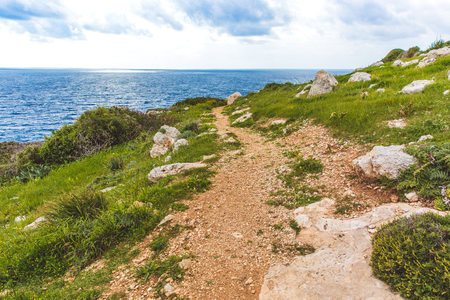 Beautiful valley by the sea. Trail leading along the coast. Seascape in Cyprus Ayia Napa. Cape Greco peninsula, national forest park Stock Photo