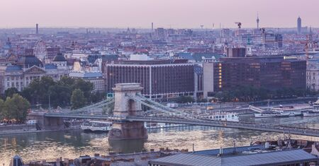 Panoramic cityscape of Chain Bridge on the Danube river. Colorful sunrise in Budapest, Hungary