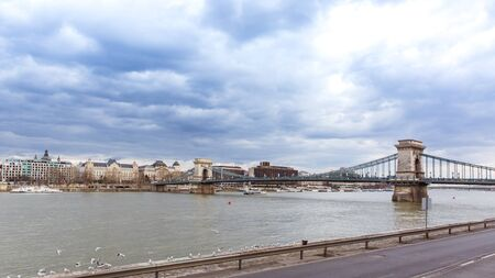 View to the Szechenyi chain bridge from promenade near Danube river in Budapest Banque d'images - 132186094