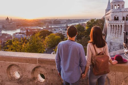 Young couple enjoy the view from the point from Fisherman Bastion in Budapest during sunrise. Reklamní fotografie