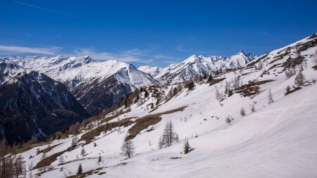 Winter landscape - Panorama of the ski resort with ski slopes and ski lifts. Alps. Austria. Karnten Banque d'images - 133304391